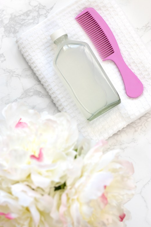 DIY micellar cleansing water for hair with pink comb