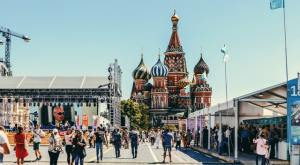 beautiful day in Russia with people walking the alley in front of architectural buildings
