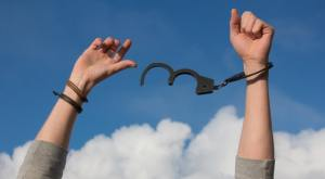 Free oneself from handcuffs finding freedom from smoking scenery on an blue sky background