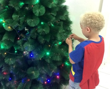Decorating the toilet brush tree.