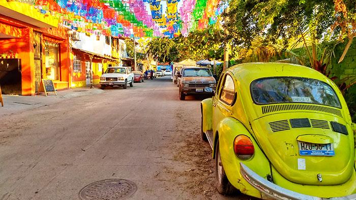 sayulita mexico color flags vw beetle