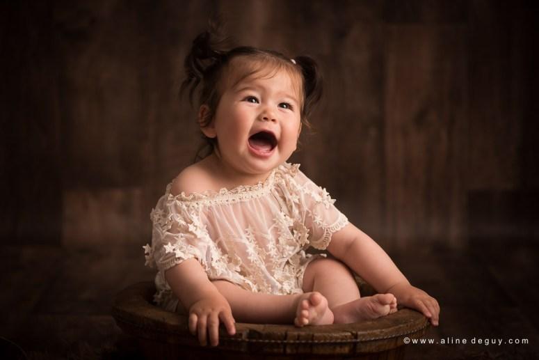 photographe bébé Neuilly, studio photo bébé, bébé un an, premier anniversaire, anniversaire bébé, photos anniversaire bébé, sourire de bébé, bébé métissé