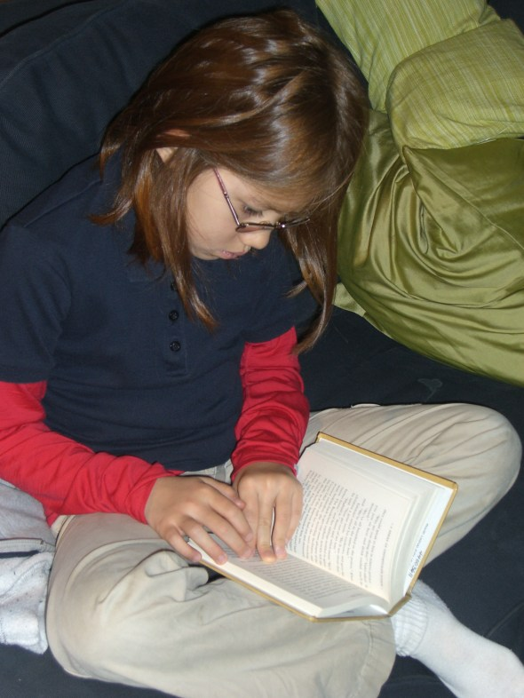 Little Girl reading The End of The Series of Unfortunate Events