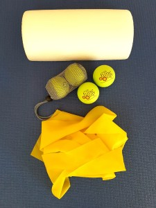 Yoga Tune Up balls, half dome and stretchyy band on a mat