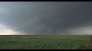 Frame grab from the F5 of a Supercell storm with a grey funnel cloud beneath.