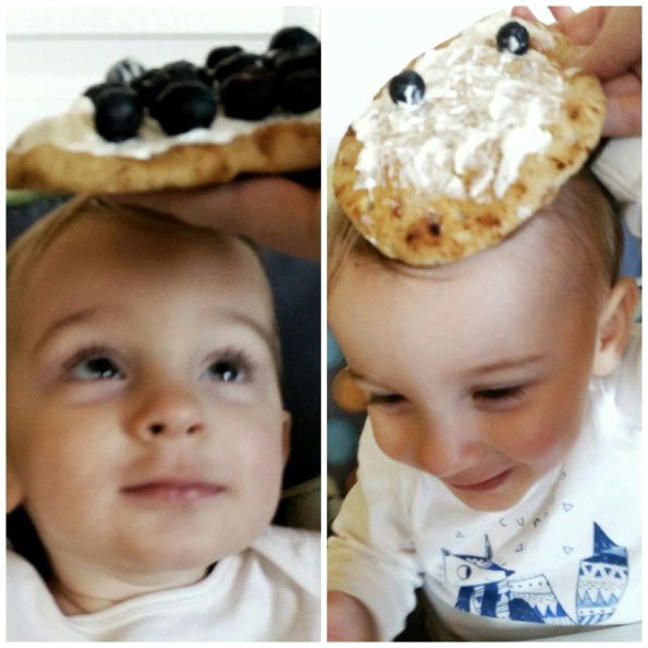 A Literary Feast | baby with blueberry pizza on head
