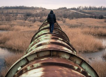Person walking on pipeline