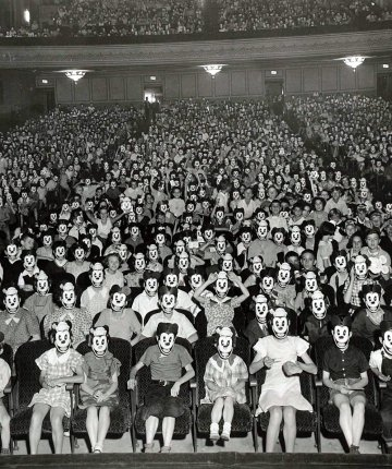black and white photo of audience