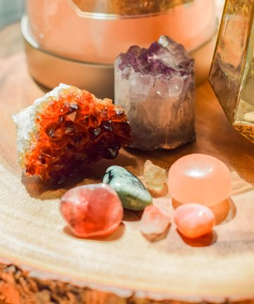 assorted crystals on wood tabletop