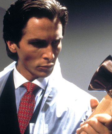 Bateman with axe in American Psycho