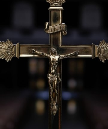 brass crucifix with jesus on it
