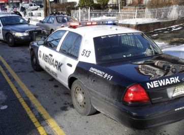 two police cars parked on street