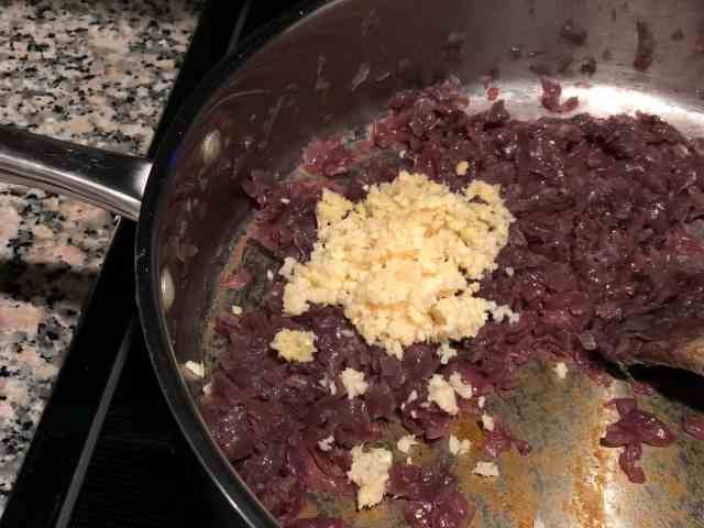 This is an image of sautéed onion and minced garlic