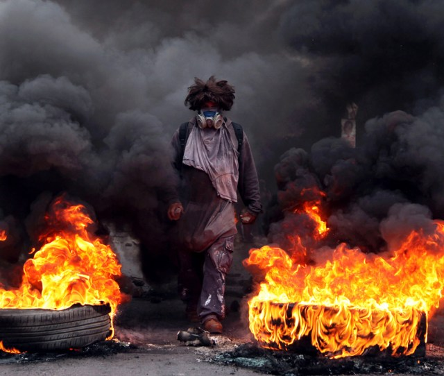 An Anti Government Protester Blocks A Road On The Outskirts Of Tegucigalpa Honduras