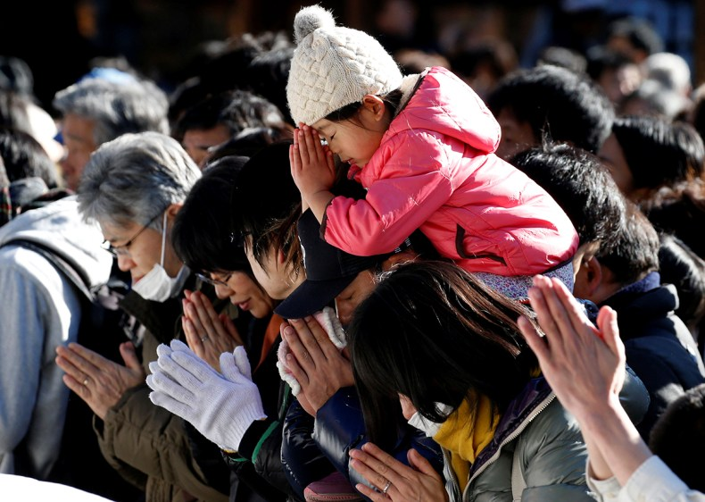 People offer prayers on the first day of the new year at the Meiji Shrine in Tokyo, Japan. [Toru Hanai/Reuters]