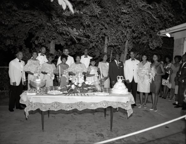 A group portrait by Littlejohn at a wedding reception buffet in Fort Worth. Racial segregation dominated American culture for the first half of the 20th century. Many states, especially those like Texas in the South, used segregation to systematically discriminate against black Americans in all areas of public life. [Calvin Littlejohn; Calvin Littlejohn Photographic Archive, Briscoe Center for American History]