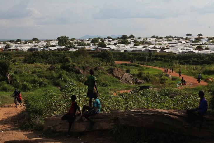 Children walk outside the POC in Juba, South Sudan, home to more than 40,000 people. [Andreea Campeanu/Al Jazeera]