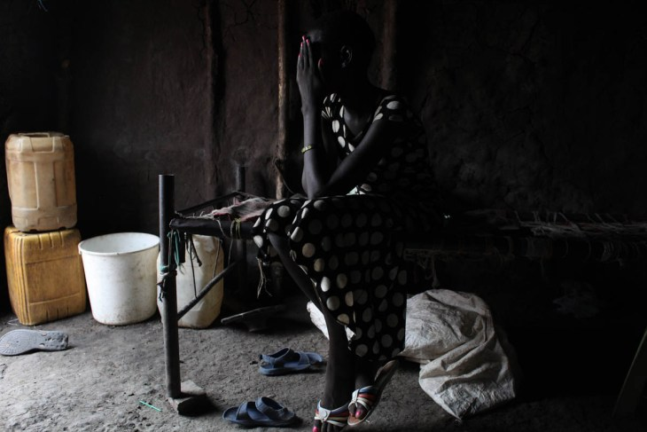 A 15-year-old girl who was held by armed forces for a week. Originally from Mayendit, she was collecting firewood outside the Protection of Civilians (POC) site near Bentiu, in December 2017. 'Soldiers came to us, they had guns and uniforms. We all tried to run away, but they caught me.' They took her to Bentiu town, and kept her for a week. She was repeatedly raped. 'One soldier took me as a wife. But when he was away, the other soldiers would come to the house and do what they wanted with me. That man didn't care. He was mean to me; he would beat me and say I was useless. I was thinking to kill myself.' She now lives in the POC near Bentiu with her family, who are supportive but very poor. She's going to school and hopes to be able to complete her studies and forget about the past. [Andreea Campeanu/Al Jazeera]