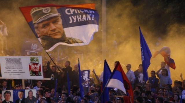 Pro-Mladic Supporters Demonstrate In Belgrade BELGRADE, SERBIA - MAY 29: Supporters of Ratko Mladic wave flags with his picture and reading in Serbian 'Serbian hero' during a rally organized