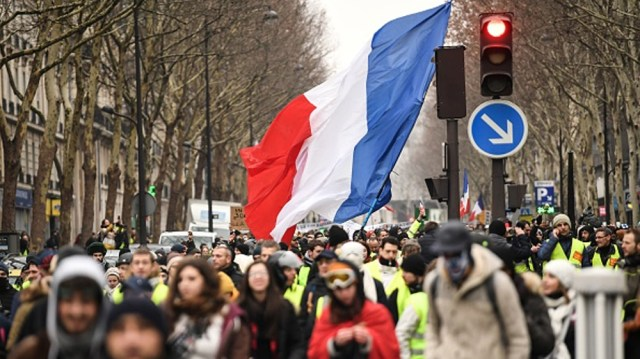 FRANCE-POLITICS-SOCIAL-DEMO People march in Paris on January 19, 2019 during a demonstration called by the yellow vests (gilets jaunes) movement in a row of nationwide protest for the tenth week