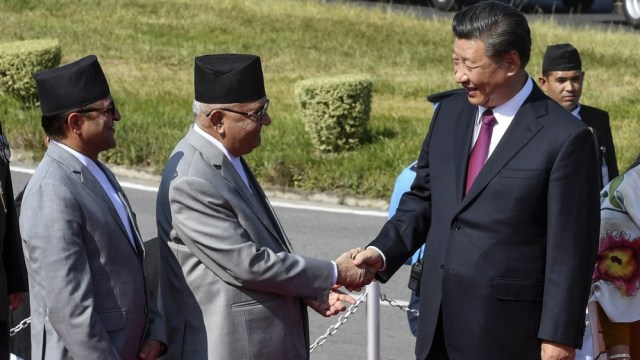 China's President Xi shakes hands with Nepal's PM Oli in Kathmandu