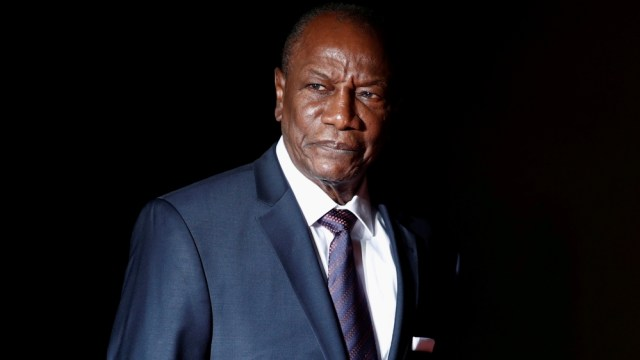 Guinea's President Alpha Conde arrives to attend a visit and a dinner at the Orsay Museum