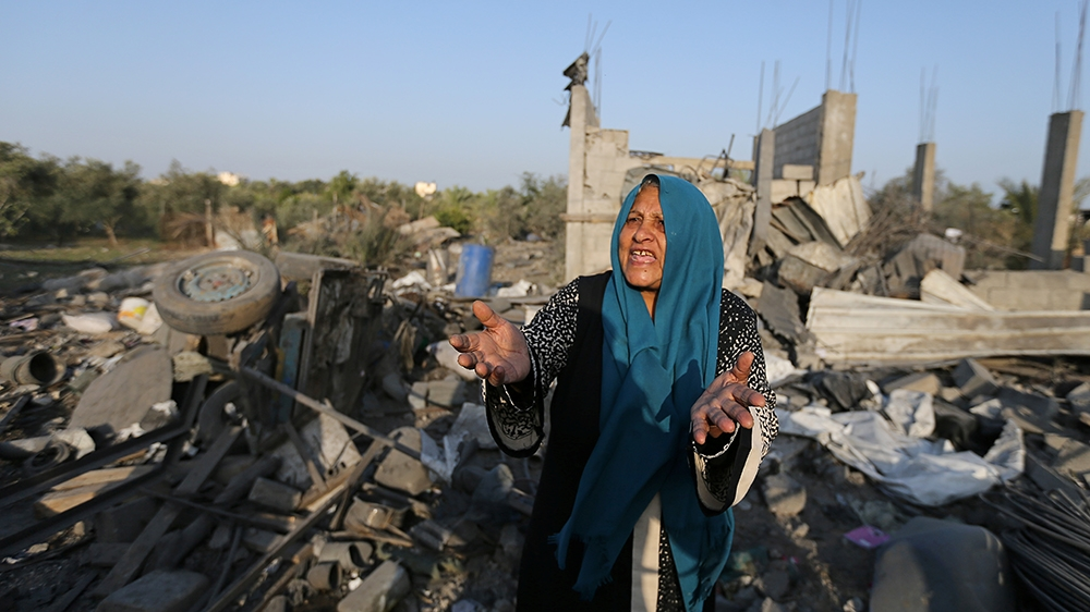 A Palestinian woman reacts as she inspects a house destroyed in an Israeli air strike in the southern Gaza Strip November 14, 2019. REUTERS/Ibraheem Abu Mustafa
