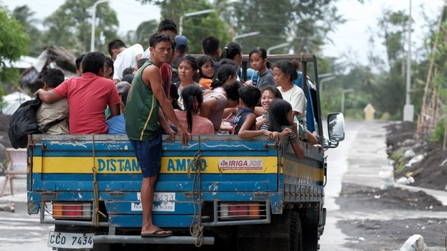 Villagers ride a truck as they are evacuated in anticipation of an approaching typhoon in Legaspi city, Albay province, Philippines, 02 December 2019. According to the latest government weather bureau