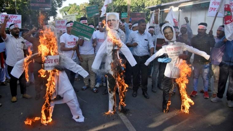 PressMirchi Activists from AASU burn effigies during a protest against the Citizenship Amendment Bill, in Guwahati