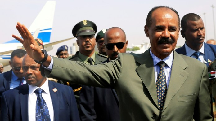 Eritrean President Isaias Afwerki waves upon his arrival for a state visit to Sudan at the Khartoum Airport