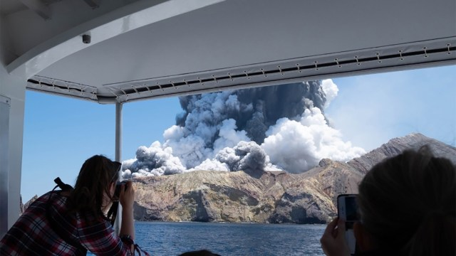 This handout photograph courtesy of Michael Schade shows the volcano on New Zealand's White Island spewing steam and ash moments after it erupted on December 9, 2019. New Zealand police said at least