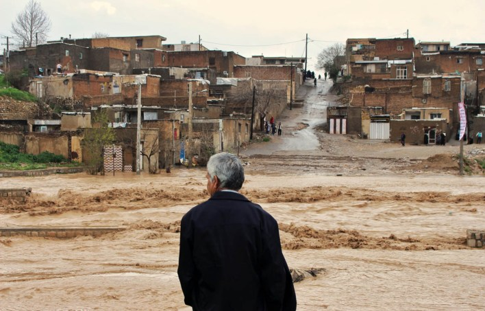 A man watches as floodwaters hit the city of Khorramabad in the western province of Lorestan, Iran. [Erfan Keshvari/ISNA/AP Photo]