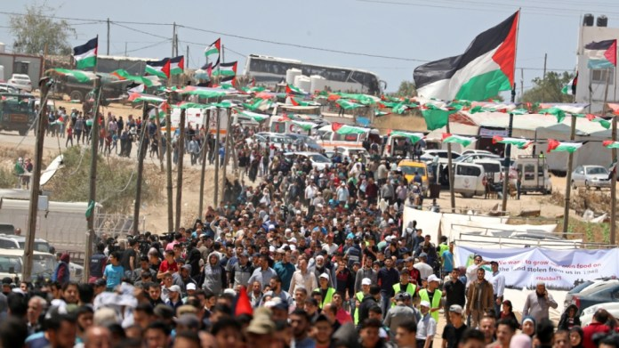 Palestinians gather during a protest marking the 71st anniversary of the 'Nakba', or catastrophe, when hundreds of thousands fled or were forced from their homes in the war surrounding Israel's indepe