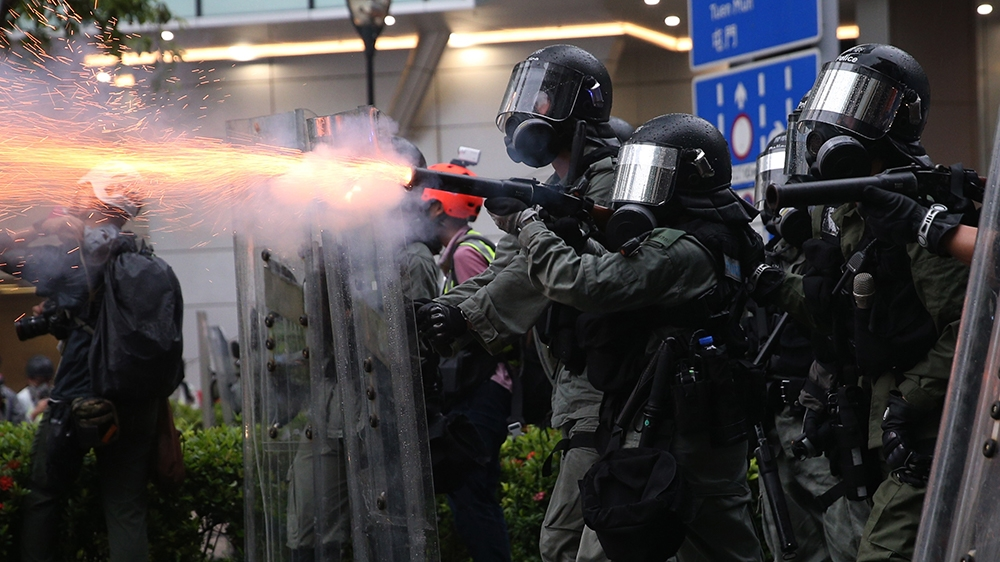 Riot police fire tear gas as protesters take part in an anti-government rally in Kwai Fung and Tsuen Wan, Hong Kong, China, 25 August 2019. The protests were triggered last June by an extradition bil