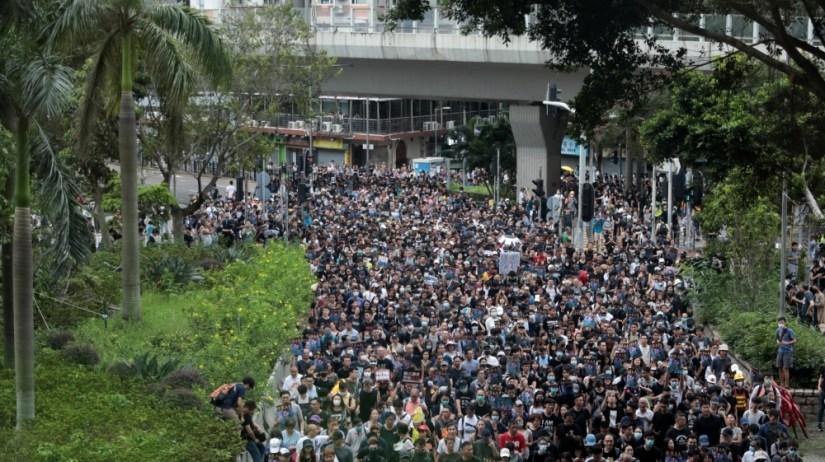 Anti-extradition bill protesters march at Mongkok, in Hong Kong