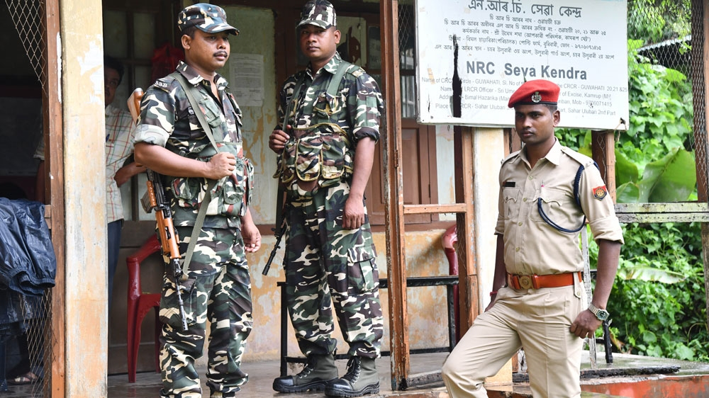 Security personnel stand guard at a NRC centre in Guwahati, India