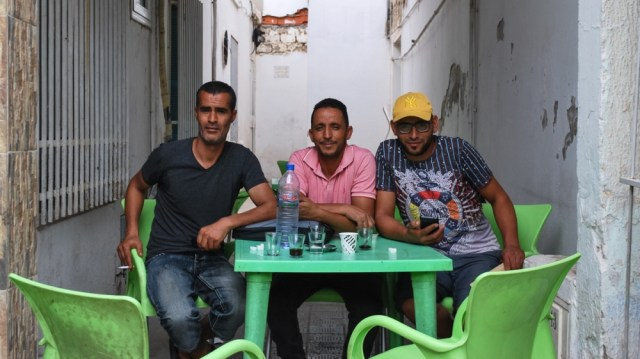 Three men sat at Cafe Samarkand in Sidi Bouzid, including Nacer Gharbi (farmer cited in the piece). Other two are his relatives. [Layli Foroudi/Al Jazeera]