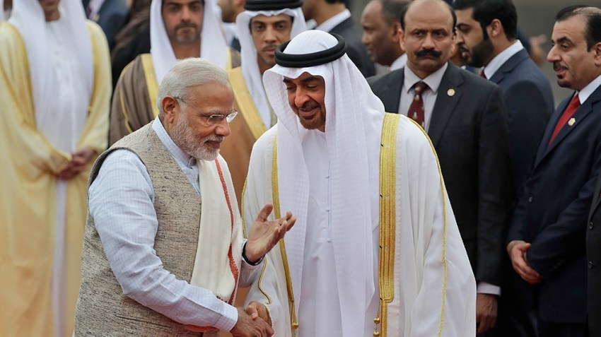 Indian Prime Minister Narendra Modi, left, gestures as he receives Abu Dhabi's crown prince, Sheikh Mohammed bin Zayed Al Nahyan at the airport in New Delhi, India, Tuesday, Jan. 24, 2017. The crown p