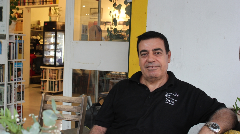 Michel al-Rahib, Palestinian citizens of Israel and owner of a coffee and bookshop in Jaffa says he doesn't see the point in voting but can't find an alternative. [Arwa Ibrahim/Al Jazeera]