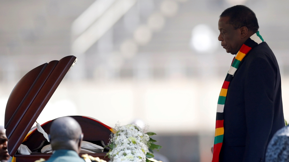 Zimbabwean President Emmerson Mnangagwa, pays his last respects during a state funeral of Zimbabwe's longtime ruler Robert Mugabe