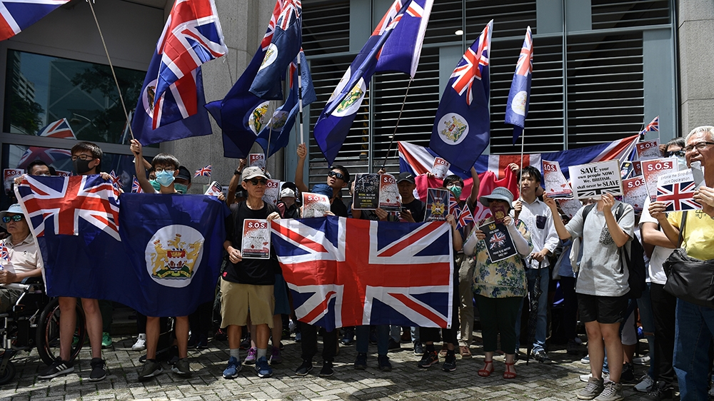 Pro-democracy demonstrators gather outside the British Consulate-General building in Hong Kong on September 15, 2019, as they called on Britain to ramp up pressure against Beijing following three mont