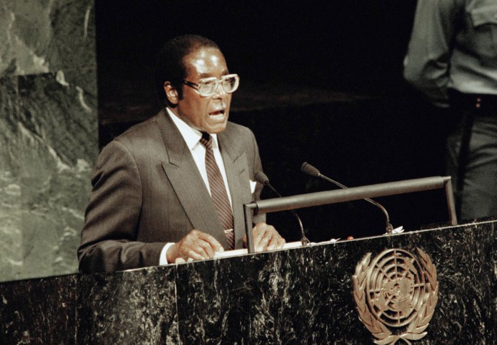 After the land reform was passed, Western nations slapped sanctions on the country. Mugabe blamed those sanctions for the economic collapse that followed. [File: AP Photo]