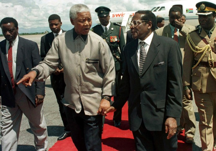 Mugabe and South Africa's former President Nelson Mandela were political leaders and contemporaries whose backgrounds were very similar, however their paths eventually diverged. [File: Rob Cooper/Reuters]