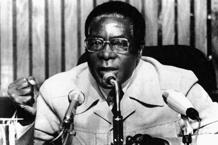 When Mugabe took power, Zimbabwe began to recover from conflict. But a land reform policy that saw black farmers take over white-owned farms sparked domestic outrage. [File: AP Photo]