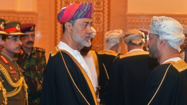 Oman's newly sworn-in Sultan Haitham bin Tariq al-Said receives condolences during the funeral of his cousin, the late Sultan Qaboos in Muscat