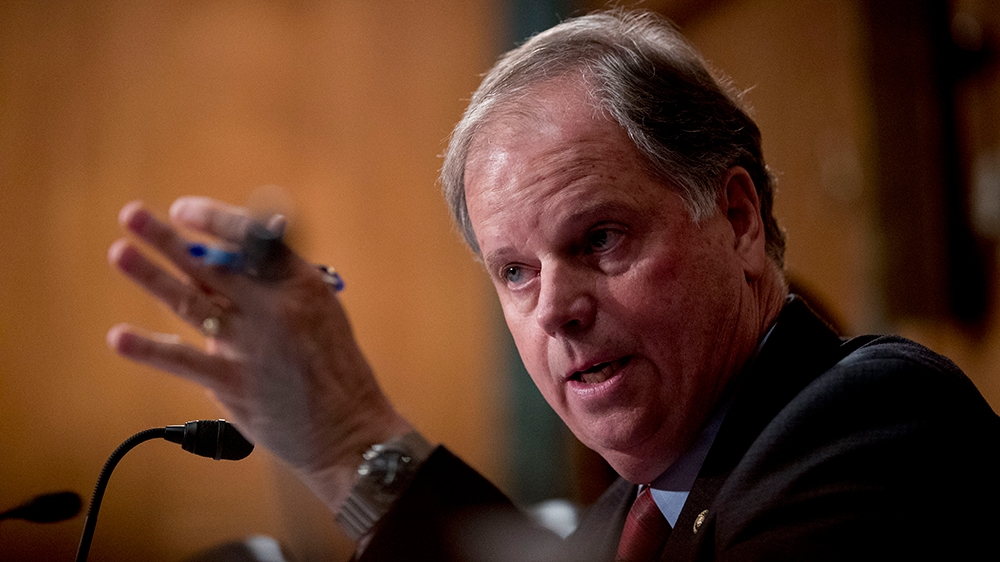 Sen. Doug Jones, D-Ala., speaks at a Senate Banking Committee hearing on