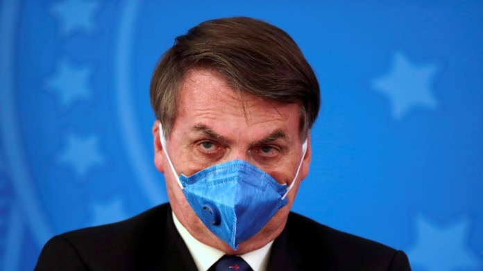 Brazil's President Jair Bolsonaro is pictured with his protective face mask at a press statement during the coronavirus disease (COVID-19) outbreak in Brasilia