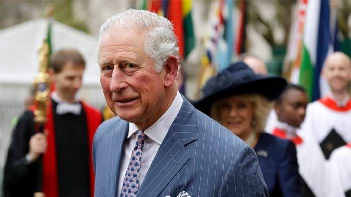 Britain's Prince Charles and Camilla the Duchess of Cornwall, in the background, leave after attending the annual Commonwealth Day service at Westminster Abbey in London, Monday, March 9, 2020. The an