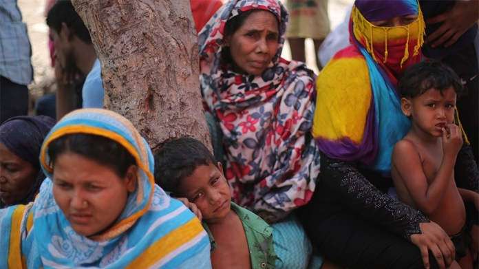 Rohingya women and kids are seen at the make-shift camp after a fire broke out in the early hours of Sunday morning, destroying their refugee camp in Kalindi Kunj area in New Delhi. No loss of life ha