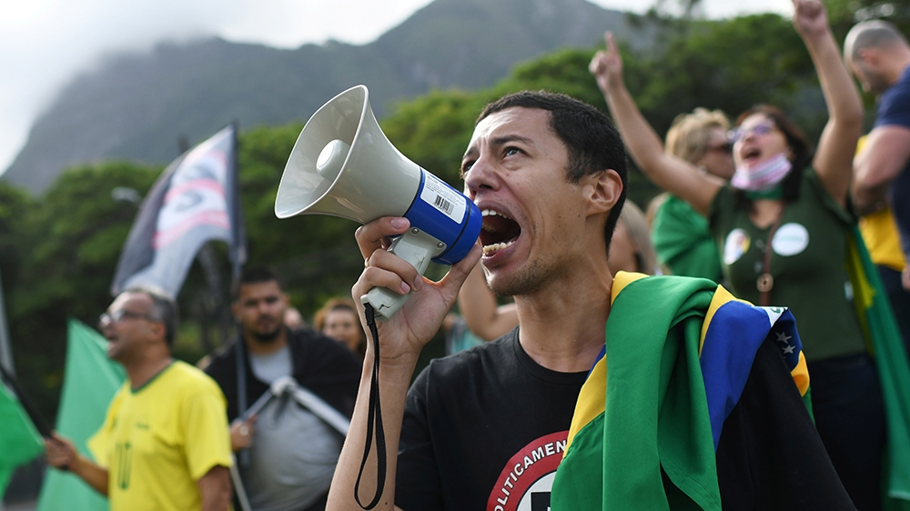 Demonstrators take part in a protest against Rio de Janeiro Governor Wilson Witzel's measures on the coronavirus disease (COVID-19) outbreak and in support of Brazil's President Jair Bolsonaro, in Rio